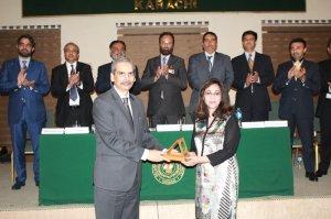Ms.Rizwan Khan, Former DG Press Information Deptt. , Karachi receiving the souvenir from Mr.Naveed Kamran Baloch Director General, NIM Karachi